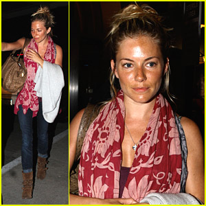 Sienna Miller Lands At LAX