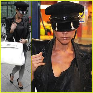 Victoria Beckham Hangs Onto Her Handbag
