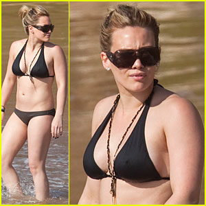 Hillary Duff shows off her curves in a black bikini on a beach in Hawaii on ...
