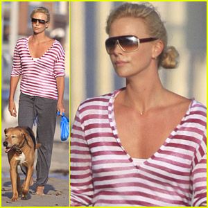 Charlize Theron Chases Her Canines