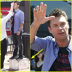 Ryan Seacrest Receives Height Help From A Box