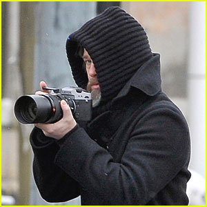 Brad Pitt Takes Snapshots in the Snow