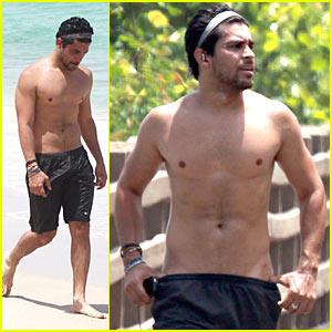 Shirtless Wilmer Valderrama Hits The Beach