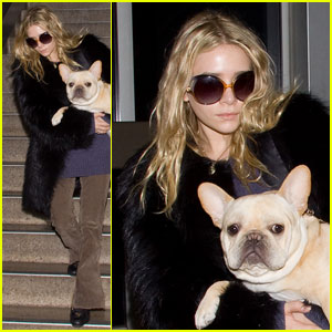 Ashley Olsen Carries Her Precious Cargo
