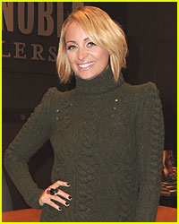 Nicole Richie Settles with Photographer
