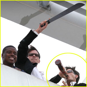 Charlie Sheen Waves Machete, Drinks 'Tiger Blood'