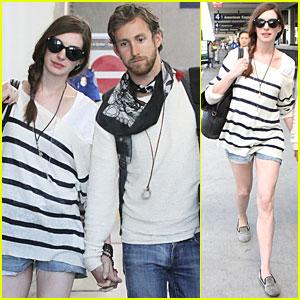 Anne Hathaway & Adam Shulman Land at LAX