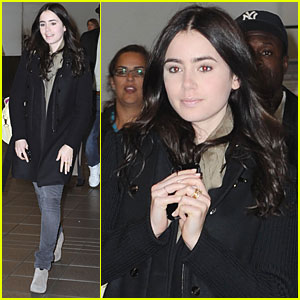 Lily Collins Lands at LaGuardia