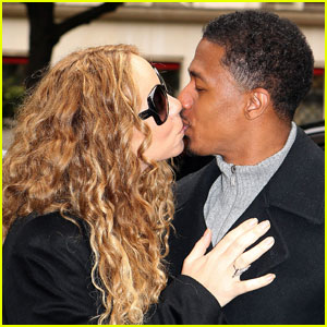 Mariah Carey & Nick Cannon Kiss for the Cameras