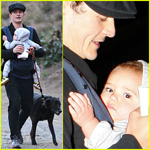 Orlando Bloom takes baby Flynn