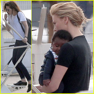 Charlize Theron & Jackson Board Private Plane in Paris