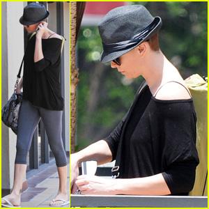 Charlize Theron Flaunts a Fedora