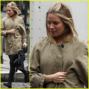 Sienna Miller Runs in the Rain!