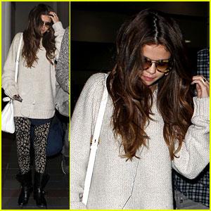 Selena Gomez Lands at LAX After Press Duties