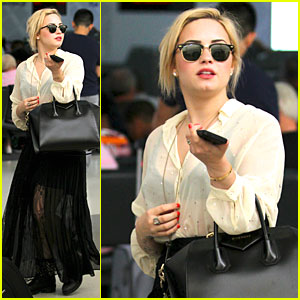 Demi Lovato: Sheer LAX Arrival After Father's Death