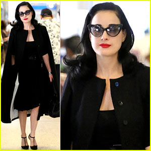 Dita Von Teese Wears Cape for Flight to Buenos Aires