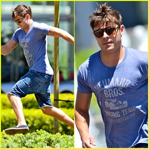 Zac Efron Leaps Into Action for Hotel Entrance