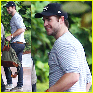 Liam Hemsworth Smiles Wide While Arriving Back in Atlanta