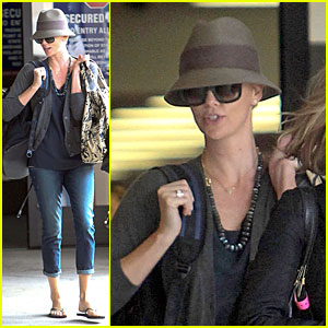 Charlize Theron: Snack Grabbing LAX Arrival!