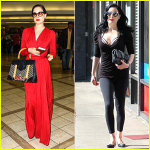 4fb4809957b4 Dita Von Teese is the lady in red while heading into LAX Airport on Tuesday  (November 12) in Los Angeles.