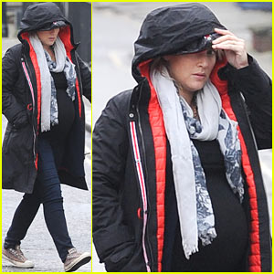 Pregnant Kate Winslet Plays Peek-a-Boo with her Hood in London