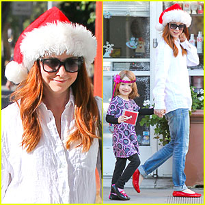 Alyson Hannigan Sports Santa Hat on Christmas Eve!