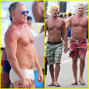 Sam Champion Strips Off Board Shorts to Show Sexy Speedo
