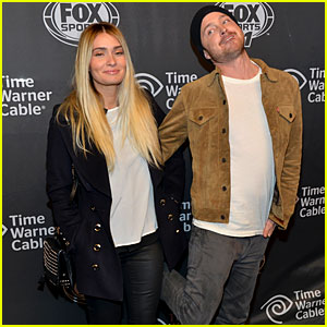 Aaron Paul Kicks His Heels Up, His Wife Seems Unimpressed