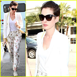 Anne Hathaway Wears Monkey Print Pants at the Airport
