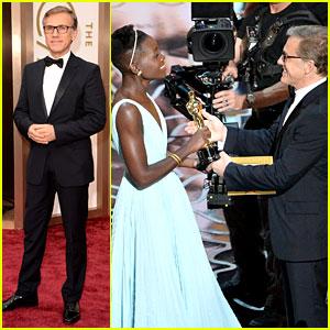 Christoph Waltz Presents to Lupita Nyong'o at Oscars 2014
