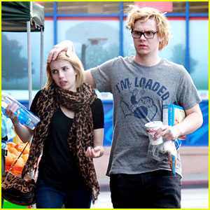 Evan Peters Rests His Hand on Fiancee Emma Roberts' Head