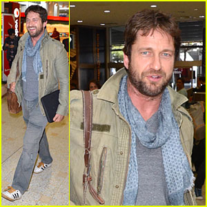 Gerard Butler Surrounds His Good Looks with Security at Sydney Airport!