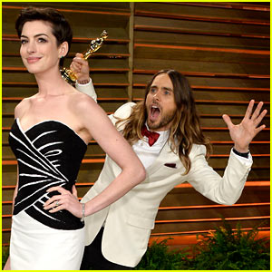 Jared Leto Photobombs Anne Hathaway at Vanity Fair Oscars Party 2014