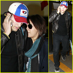 Mila Kunis & Ashton Kutcher Arrive Home from Quick Iowa Trip