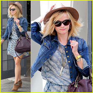 Reese Witherspoon's Hat Almost Blows Away in the Wind