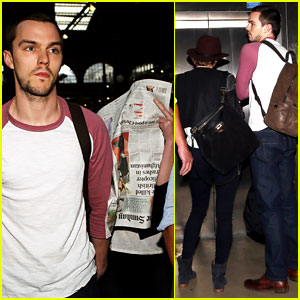 Jennifer Lawrence Hides Behind a Newspaper in Paris with Boyfriend Nicholas Hoult