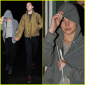 Jennifer Lawrence Hides Under a Hoodie & Uses Boyfriend Nicholas Hoult as Her Guide!