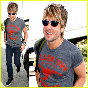 Keith Urban Takes Off for Nashville to Attend ACM Awards 2014!
