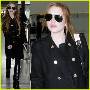 Lindsay Lohan Flies Out of Heathrow Just in Time for Coachella!