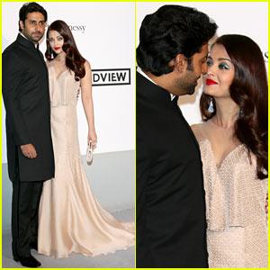 Aishwarya Rai & Husband Abishek Bachchan Share Sweet Glance at Cannes amfAR Gala 2014