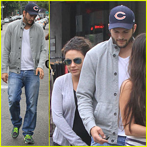 Ashton Kutcher Uses Body to Shield Mila Kunis' Baby Bump!
