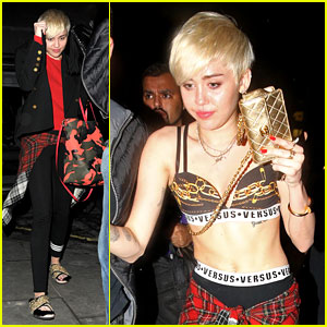 Miley Cyrus Enters a Club Fully Clothed, Leaves in Her Bra!