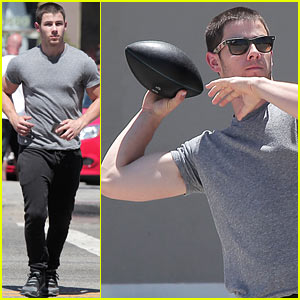 Nick Jonas' Bicep Bulges Through His T-Shirt During Football Toss