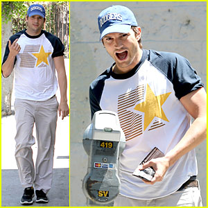 Ashton Kutcher Confronts Paparazzi on Solo Hollywood Stroll