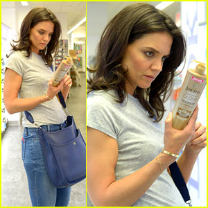 Katie Holmes Intensely Examines a Bottle of Tanning Moisturizer