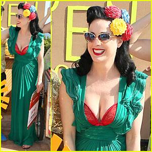 b881f8515446 Dita Von Teese Flashes Red Bra in Plunging Green Dress at Garden   Art  Party!