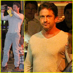 Gerard Butler Can't Get Enough of This Medieval Knight & Dragon Statue in Rio!