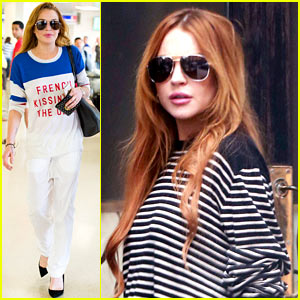 Lindsay Lohan Promotes 'French Kissing in the U.S.A.' As She Arrives Back in America