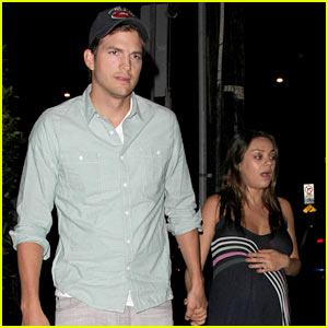 Mila Kunis Holds Onto Her Baby Bump & Ashton Kutcher's Hand