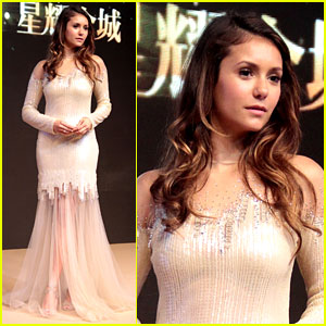 Nina Dobrev Shimmers & Shines for LUX Appearance in China